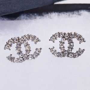 Silver tone crystals stud earrings
